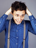Young goofy man with pimples pointing in studio Royalty Free Stock Photography