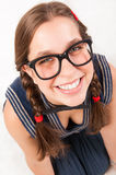 Young goofy and nerdy girl looking at camera. Stock Photography