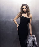 Young and gorgeous actress in a long dress Royalty Free Stock Image