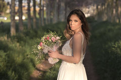 Young gorgeous bride with perfect skin and green eyes holding a bridal bouquet. Young bride with perfect skin and green eyes Flying beautiful hair royalty free stock photos