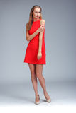 Young gorgeous caucasian blonde in red dress posing Royalty Free Stock Images