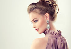 Young gorgeous girl dressed in evening gown and delicate makeup on. Royalty Free Stock Photo