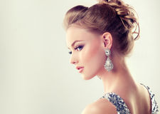 Young gorgeous girl dressed in evening gown and delicate makeup on. Portrait of young gorgeous girl dressed in evening gown,with delicate makeup on her face and Stock Image