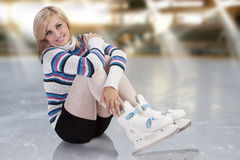 Young gorgeous girl with skates Stock Photo