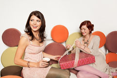 Young women with gifts Royalty Free Stock Photography