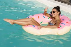 Beautiful woman enjoying hot summer day at poolside royalty free stock images