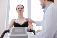 Young gorgeous lady having her cardiovascular system checked. Like a regular exercise. Athletic attractive responsible women doing some tests for her general Stock Images