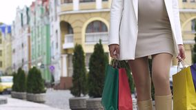 Young gorgeous pregnant lady with shopping bags going down street, black Friday. Stock footage stock footage