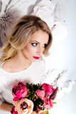 Young gorgeous woman, bride, blond long curly hair, studio decor Royalty Free Stock Photos