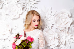 Young gorgeous woman, bride, blond long curly hair, studio decor Royalty Free Stock Photography