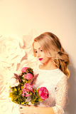 Young gorgeous woman, bride, blond long curly hair, studio decor Stock Image