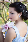 Young Gorgeous Woman With Magnolia Stock Images
