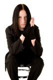 Young goth sitting on a bar chair Stock Image