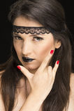 Young gothic beautiful woman with red nails Stock Photo
