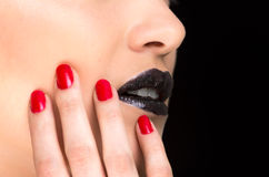 Young gothic beautiful woman with red nails. Young gothic beautiful woman with black makeup and red nails closeup stock images