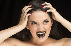 Young gothic desperate woman with red nails. Young gothic desperate woman with black makeup and red nails royalty free stock images