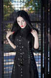 Young gothic style brunette woman in black dress. Young gothic style attractive brunette woman in black dress royalty free stock image