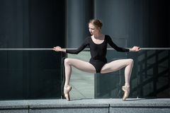 Young graceful ballerina in black bathing suit on Stock Images