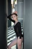 Young graceful ballerina in black bathing suit on Royalty Free Stock Photos