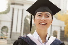 Young Graduate in Cap and Gown Royalty Free Stock Photo