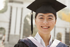 Young Graduate in Cap and Gown Royalty Free Stock Photos