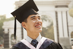 Young Graduate in Cap and Gown Royalty Free Stock Images