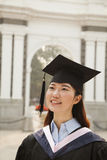 Young Graduate in Cap and Gown Royalty Free Stock Image