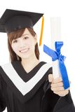Young graduate girl student holding and showing diploma Royalty Free Stock Image