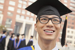 Young Graduate with Glasses Smiling, Portrait Royalty Free Stock Images