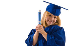 Young Graduate. A young graduate in her cap and gown, leaning her head to the side, clutching her diploma and smiling. Isolated on white, horizontal layout with Royalty Free Stock Image