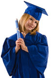 Young Graduate. A young graduate in her cap and gown, leaning her head to the side, clutching her diploma and smiling. Isolated on white, vertical layout with Stock Photography