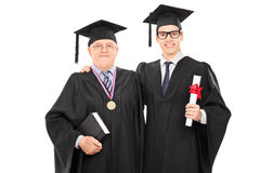 Young graduate student posing with the dean. Isolated on white background Stock Photography