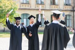 young graduated students spending time stock photos