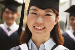 Young Graduates in Cap and Gown Stock Photography