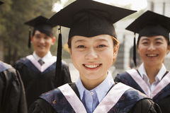 Young Graduates in Cap and Gown Royalty Free Stock Photos