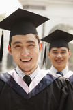 Young Graduates in Cap and Gown Royalty Free Stock Photography