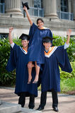 Young Graduates Celebrating Royalty Free Stock Images