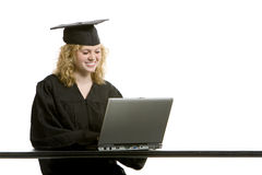 Young graduation girl using computer Stock Photos