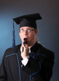 Young graduation man Stock Photos