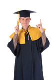 Young graduation man pointing finger upwards. Isolated on white Royalty Free Stock Photo