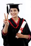 Young graduation student making thumbsup gesture Royalty Free Stock Image