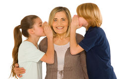 Young grandmother with nephew and niece standing on white backgr Royalty Free Stock Images
