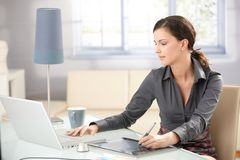 Young Graphic Designer Working At Home Royalty Free Stock Images