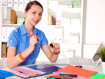 Young graphic designer working on laptop using tablet at home Royalty Free Stock Image