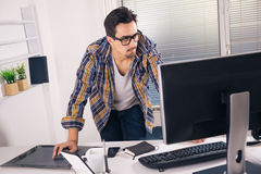 Young graphic designer. Working in office Royalty Free Stock Images
