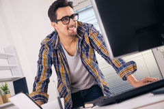 Young graphic designer. Working in office Royalty Free Stock Photography