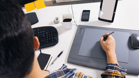 Young graphic designer. Working in office stock photo