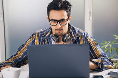Young graphic designer. Working in office Royalty Free Stock Photo