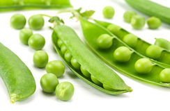 Young grean peas on white royalty free stock photos