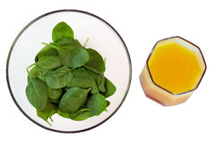 Young  green spinach in a transparent   plate, top view, isolate Stock Image